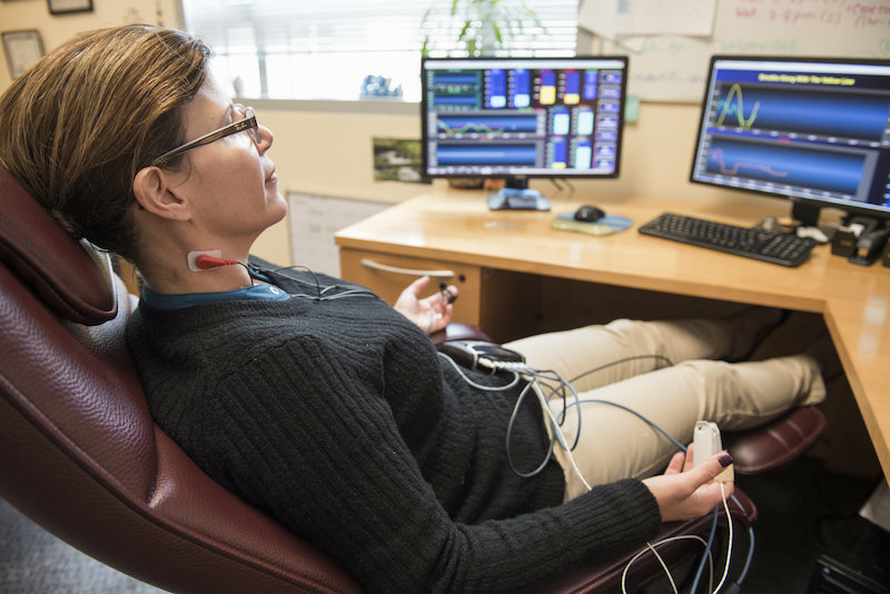 Dr. Nathaly Shoua-Desmarais practices diaphragmatic breathing using biofeedback. Credit: Florida International University